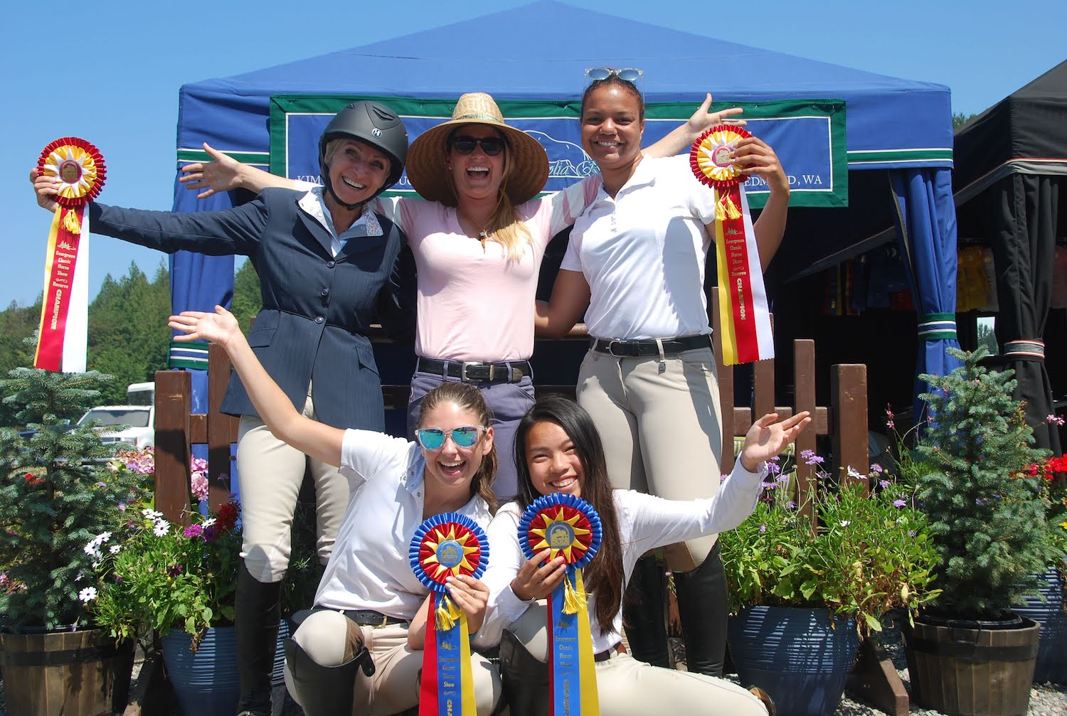 Magnolia Ridge riders posing with their ribbons