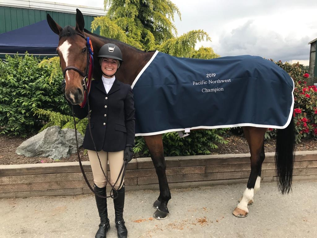Jacque poses with her horse after winning 2019 Pacific Northwest Champion